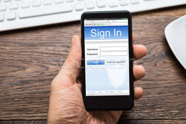 Person Hands With Mobile Phone Showing Signing Of Account Stock photo © AndreyPopov