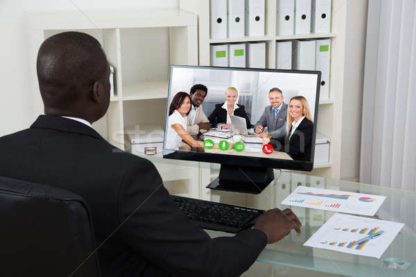 Businessman Video Chatting With Colleagues On Computer Stock photo © AndreyPopov