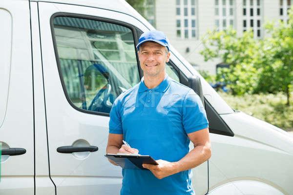 Trabalhador caminhão escrita clipboard jovem feliz Foto stock © AndreyPopov