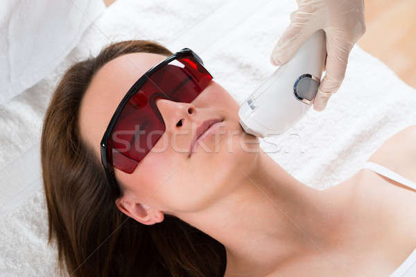 Woman Receiving Laser Epilation Treatment Stock photo © AndreyPopov