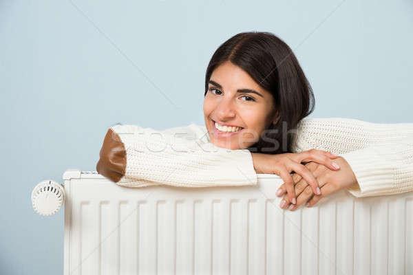 Donna radiatore giovani felice bianco Foto d'archivio © AndreyPopov