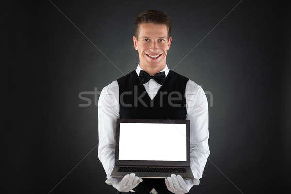 Feliz garçom laptop retrato exibir Foto stock © AndreyPopov
