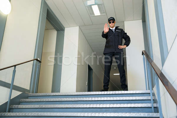 Stock photo: Security Guard Making Stop Gesture