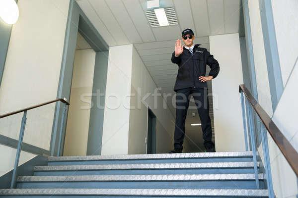 Arrêter geste Homme permanent Photo stock © AndreyPopov