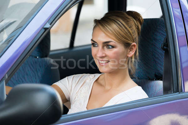 Smiling Woman Driving Car Stock photo © AndreyPopov