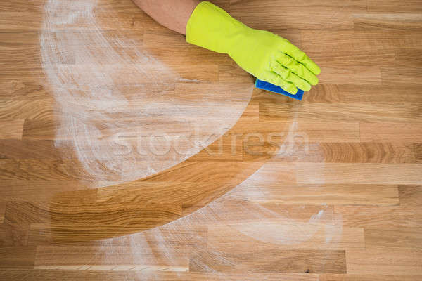 Man Cleaning Dust On Wooden Table Stock photo © AndreyPopov