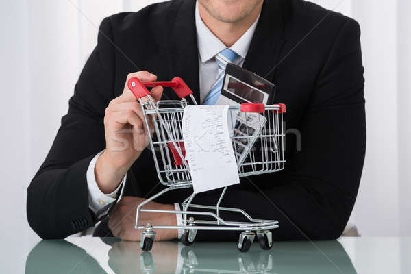 Close-up Of Man Holding Shopping Trolley Stock photo © AndreyPopov