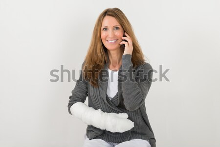 Woman With Broken Hand Talking On Mobile Phone Stock photo © AndreyPopov