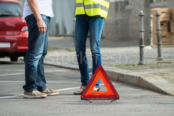 Pár áll figyelmeztető jel törött lefelé autó Stock fotó © AndreyPopov