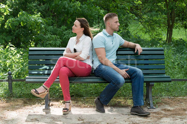 Couple Sitting Back To Back On Bench Stock photo © AndreyPopov
