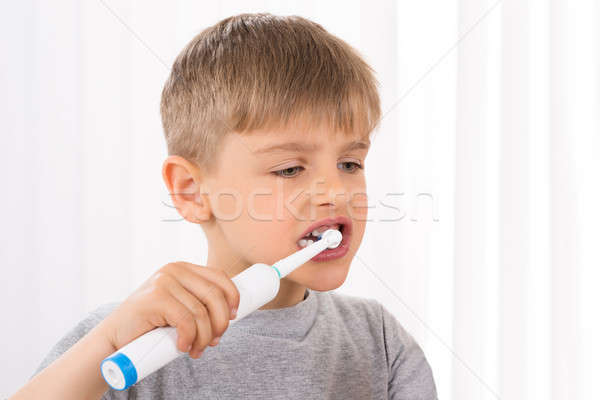 Close-up Of Boy Brushing Teeth Stock photo © AndreyPopov