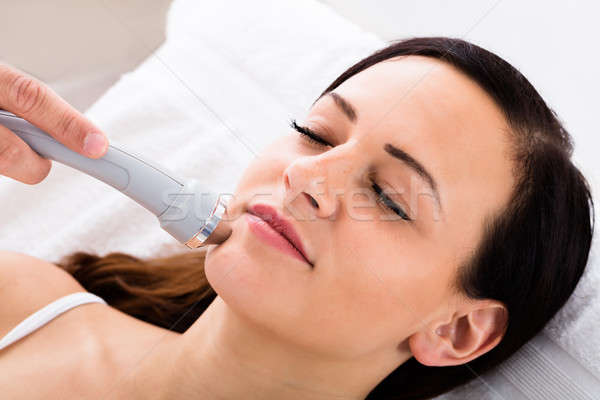 Stock photo: Woman Receiving Face Massage From Therapist