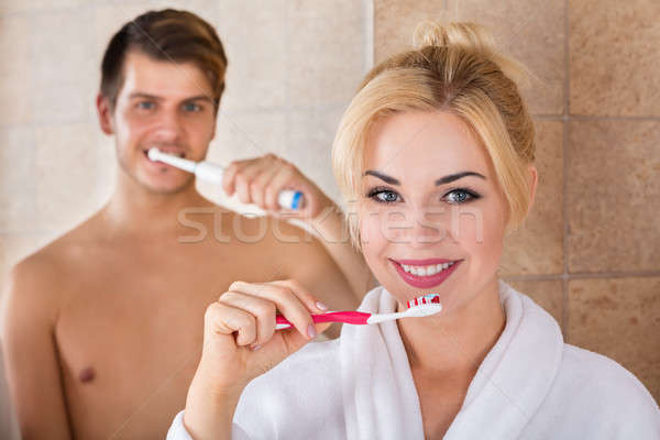 Portrait Of Man And Woman Brushing Teeth Stock photo © AndreyPopov