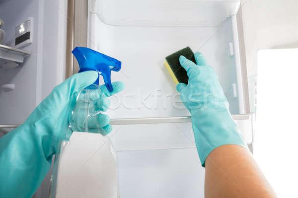 Kişi el temizlik buzdolabı sprey Stok fotoğraf © AndreyPopov