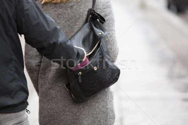 Persona rubare borsa borsa primo piano ragazza Foto d'archivio © AndreyPopov