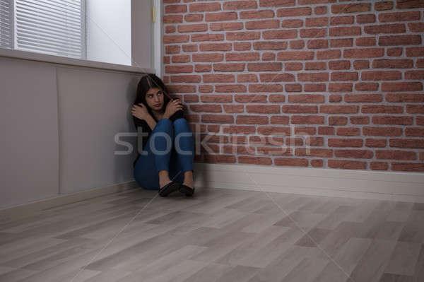 Nő ül sarok fiatal nő szoba félelem Stock fotó © AndreyPopov