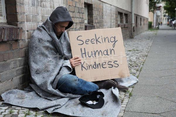 Beggar Showing Seeking Human Kindness Sign On Cardboard Stock photo © AndreyPopov