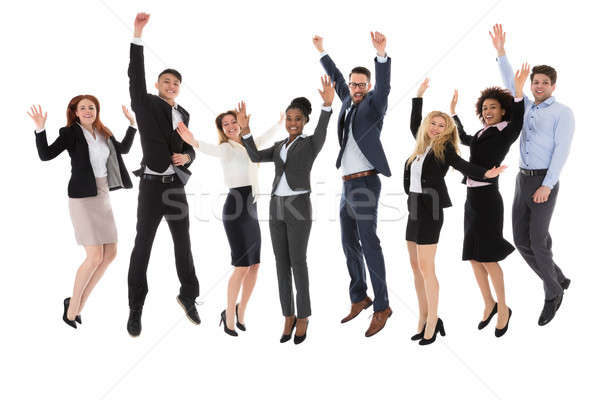 Excited Businesspeople Raising Their Hands Stock photo © AndreyPopov