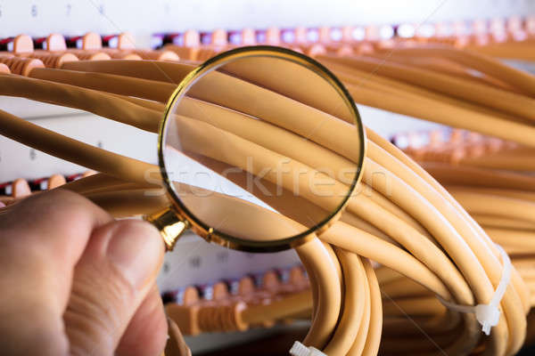 Hand Examining Network Cables In Server Room Stock photo © AndreyPopov