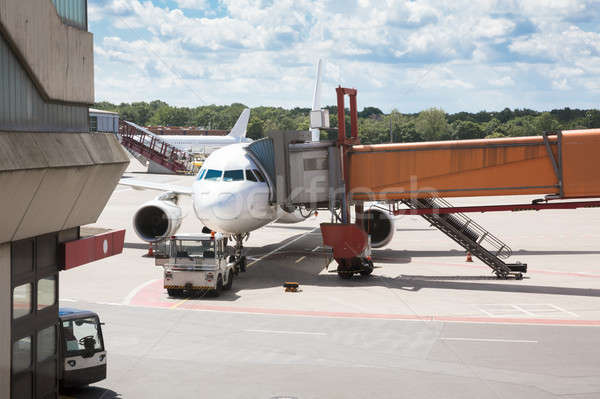 Passenger boarding bridge attached to airplane Stock photo © AndreyPopov