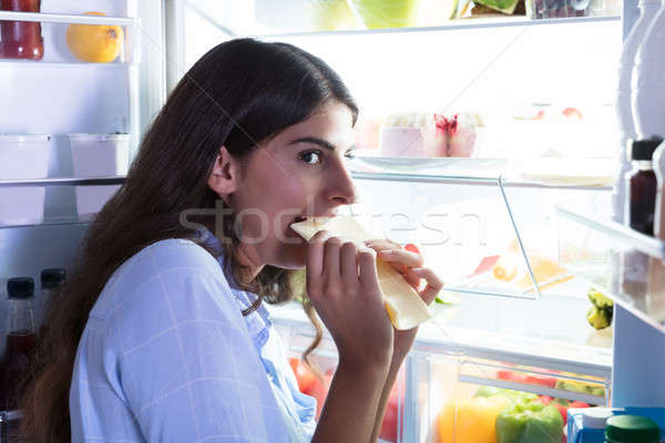 Woman Eating Slice Of Cheese Stock photo © AndreyPopov