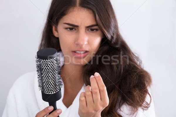 Nő fürdőköpeny tart fésű néz haj Stock fotó © AndreyPopov