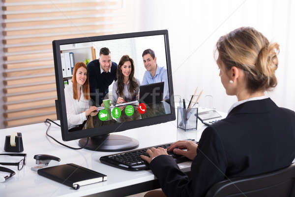 Businesswoman Video Conference With Her Colleagues Stock photo © AndreyPopov
