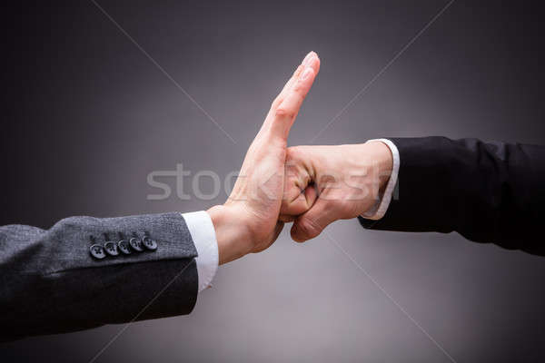 Human Hand Stopping Fist Of Angry Person Stock photo © AndreyPopov