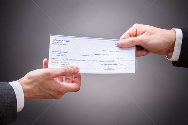 Businessperson Giving Cheque To Colleague Stock photo © AndreyPopov