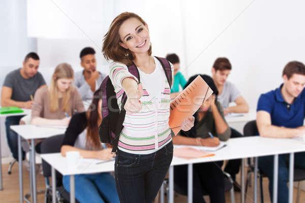 Stockfoto: Glimlachend · vrouwelijke · student · boeken · portret