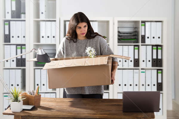 Businesswoman Carrying Her Belongings In Office Stock photo © AndreyPopov