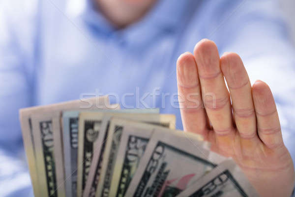 Man Rejecting An Offer Of Money Stock photo © AndreyPopov