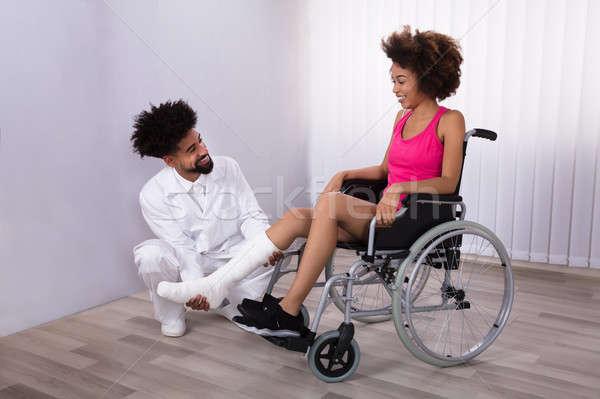 Physiotherapist Examining Leg Of Female Patient Stock photo © AndreyPopov