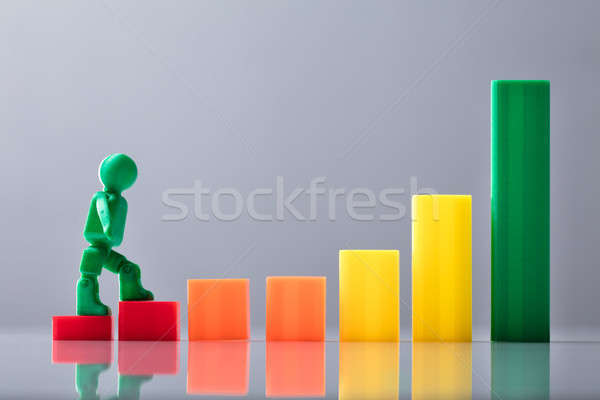 Human Figure Walking On Increasing Business Graph Stock photo © AndreyPopov