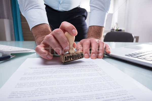 Businessman Stamping Approved On Document Stock photo © AndreyPopov