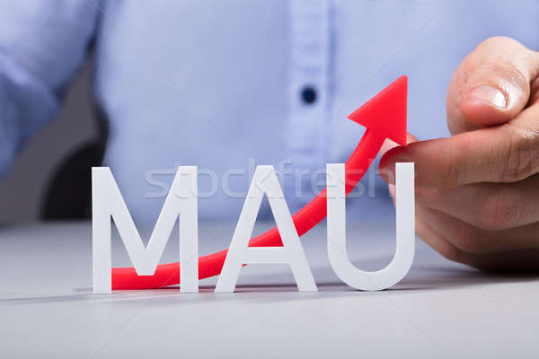 Person's Hand Touching Increasing MAU Graph Stock photo © AndreyPopov