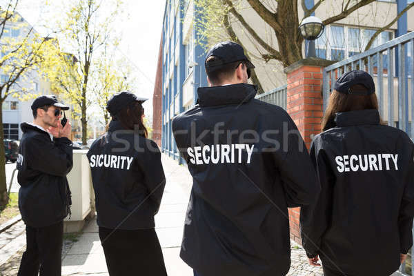 Security Guards Standing Outside Building Stock photo © AndreyPopov