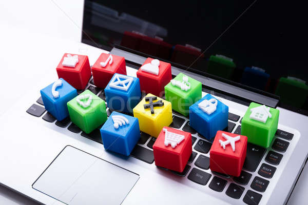 Vivid Icons Cubic Blocks On Laptop Keypad Stock photo © AndreyPopov