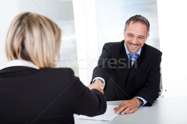 Businessman at the interview shaking hands Stock photo © AndreyPopov