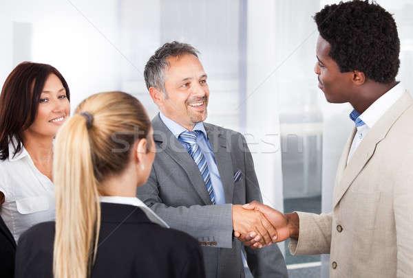 Több nemzetiségű üzletemberek kezet fog kettő üzletemberek kollégák Stock fotó © AndreyPopov