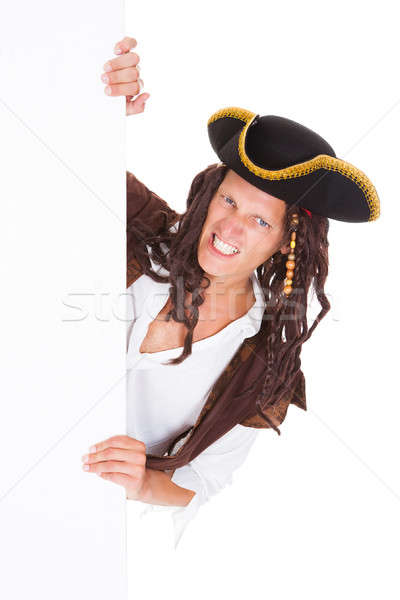 Pirate Holding Placard In Mouth Stock photo © AndreyPopov