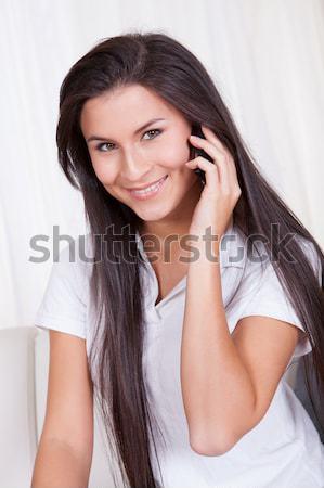 Mutlu kadın cep telefonu gündelik mavi gömlek Stok fotoğraf © AndreyPopov