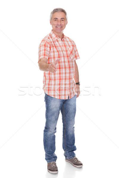 Feliz homem maduro oferta aperto de mão branco homem Foto stock © AndreyPopov