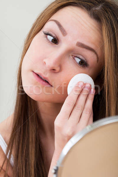 Woman Cleansing Her Face Stock photo © AndreyPopov