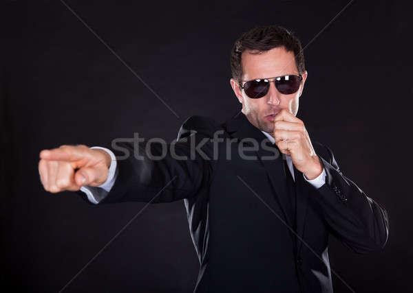 Portre genç makas parmak yalıtılmış siyah Stok fotoğraf © AndreyPopov