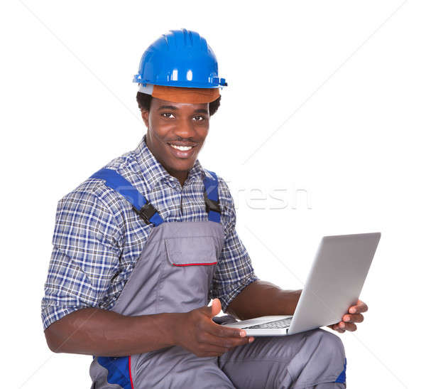 Male Craftsman Holding Laptop Stock photo © AndreyPopov