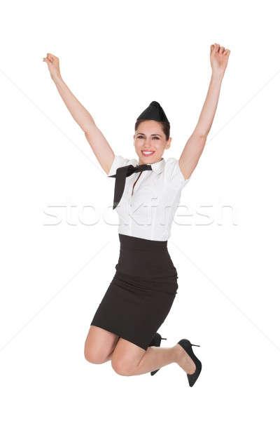 возбужденный прыжки изолированный белый женщину Сток-фото © AndreyPopov