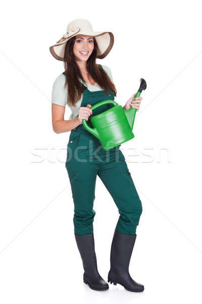 Beautiful Happy Woman Holding Watering Can Stock photo © AndreyPopov