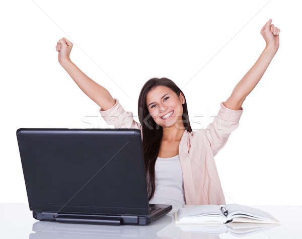 Happy female office worker rejoicing Stock photo © AndreyPopov