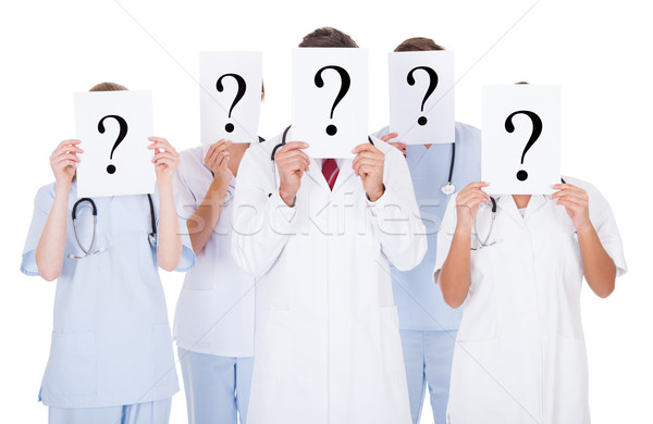 Group Of Doctors With Question Mark Sign Stock photo © AndreyPopov